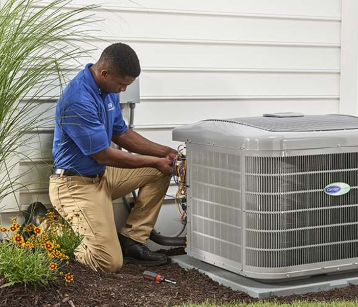 HVAC technician doing replacement The Woodlands, TX