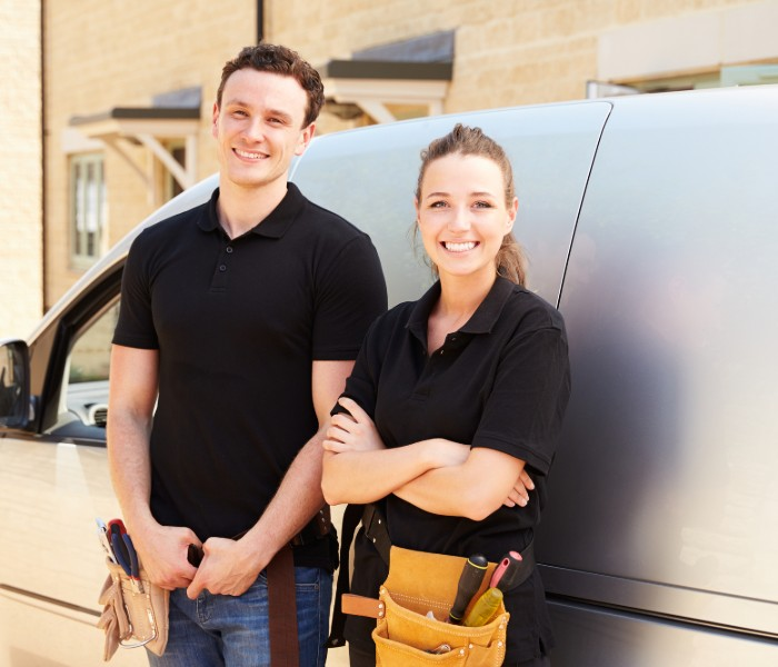 HVAC technicians in The Woodlands doing HVAC service