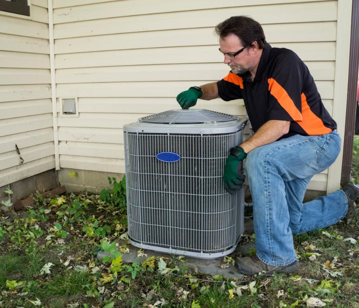 HVAC technician doing AC tune-up in The Woodlands